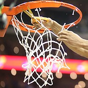 Kansas guard Devonte' Graham (4) cuts down his share of the net following the JayhawksÕ 81-70 win over the Mountaineers in the championship game of the Big 12 Tournament, Saturday, March 10, 2018 at Sprint Center in Kansas City, Mo.