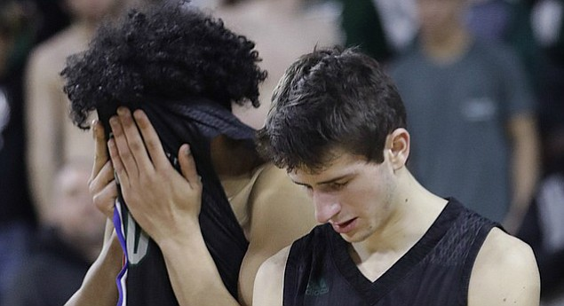 Free State seniors Reece White-Downing (10), left, and Garrett Luinstra (3) show their disappointment after a 51-40 loss in the Firebirds' 6A state championship game against Blue Valley Northwest Saturday, March 10, 2018 at Charles Koch Arena in Wichita.