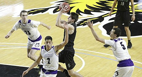 Free State senior Garrett Luinstra (3) scores two of his 16 points in the Firebirds' 6A state championship loss against Blue Valley Northwest on Saturday, March 10, 2018 at Charles Koch Arena in Wichita.