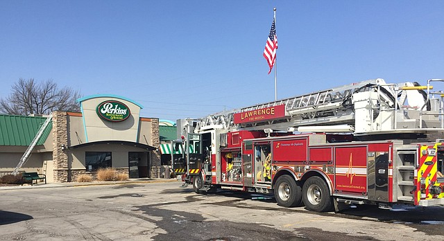 Lawrence fire crews remain on scene at Perkins, 1711 W 23rd St., Monday afternoon, March 12, 2018, following a morning fire at the restaurant.