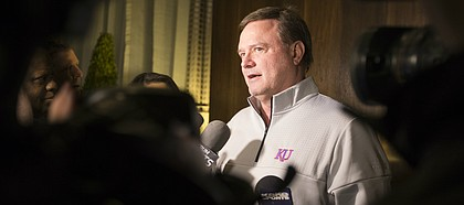 Kansas head coach Bill Self talks with media members at the Hotel Ambassador upon the Jayhawks' arrival in Wichita on Tuesday, March 13, 2018.