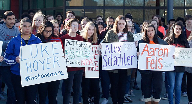 Students at Lawrence High walk out of class Wednesday, March 14, 2018, as part of a national protest against gun violence.