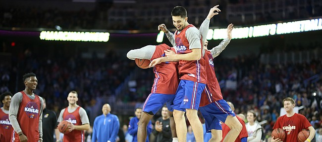 Kansas guard Sam Cunliffe, center, celebrates a 360 jam with teammates Mitch Lightfoot and Malik Newman at the end of the Jayhawks' practice on Wednesday, March 14, 2018 at Intrust Bank Arena in Wichita, Kan.