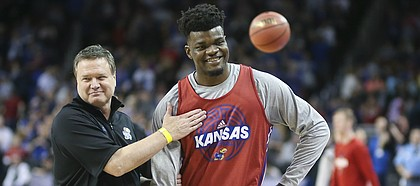 Kansas head coach Bill Self gives a pat on the chest to Kansas center Udoka Azubuike (35) at the conclusion of the Jayhawks' practice on Wednesday, March 14, 2018 at Intrust Bank Arena in Wichita, Kan.
