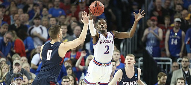 Kansas guard Lagerald Vick (2) intercepts a pass to Penn forward Max Rothschild (0) during the first half, Thursday, March 15, 2018 at Intrust Bank Arena in Wichita, Kan. At right is Penn guard Ryan Betley (21).