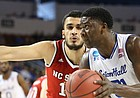 Seton Hall center Angel Delgado (31) moves to the bucket against North Carolina State center Omer Yurtseven (14) during the second half, Thursday, March 15, 2018 at Intrust Bank Arena in Wichita, Kan.