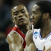 North Carolina State guard Markell Johnson, left, covers Seton Hall guard Khadeen Carrington (0) during the first half of an NCAA college basketball tournament first-round game, Thursday, March 15, 2018, in Wichita, Kan. (AP Photo/Orlin Wagner)