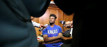 Kansas center Udoka Azubuike (35) takes questions from media members in the team locker room on Friday, March 16, 2018 at Intrust Bank Arena in Wichita, Kan.
