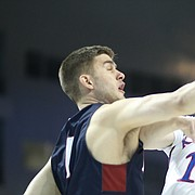 Kansas guard Sviatoslav Mykhailiuk (10) tries to get a shot off against Penn forward Max Rothschild (0) during the first half, Thursday, March 15, 2018 at Intrust Bank Arena in Wichita, Kan.
