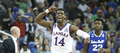 Kansas guard Malik Newman (14) pumps his fist as the Jayhawks lock up the win against Seton Hall with seconds remaining in the game, Saturday, March 17, 2018 in Wichita, Kan.