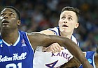Kansas forward Mitch Lightfoot (44) works for position with Seton Hall center Angel Delgado (31) and Seton Hall guard Myles Powell (13) during the second half, Saturday, March 17, 2018 in Wichita, Kan.