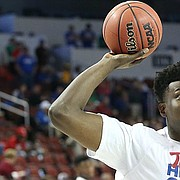 Kansas sophomore Udoka Azubuike prepares to shoot a layup in pregame warmups Saturday before KU's game against Seton Hall in the second round of the NCAA Tournament at Intrust Bank Arena.