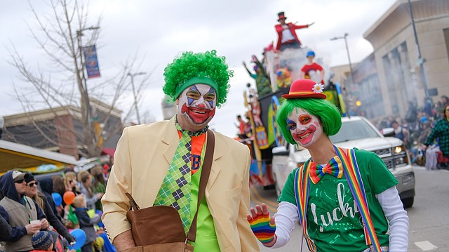 Clowns and the crew of The Sandbar's float bring up the rear of the Lawrence St. Patrick's Day Parade on Saturday, March 17, 2018, on Massachusetts Street.