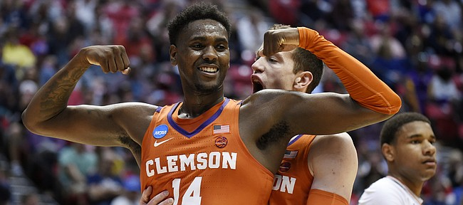 Clemson forward Elijah Thomas, front, celebrates a basket with forward David Skara during the first half of a second-round NCAA men's college basketball tournament game against Auburn on Sunday, March 18, 2018, in San Diego.