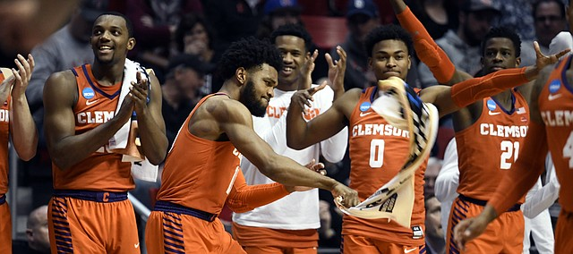 Players on the Clemson bench react during the first half of the team's second-round NCAA college basketball tournament game against Auburn on Sunday, March 18, 2018, in San Diego. (AP Photo/Denis Poroy)