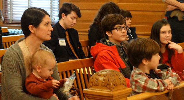 Melissa Penny, of Wichita, sits with four of her five children during a legislative committee hearing after she and her husband, Devin, testified in favor of a bill that would guarantee that faith-based adoption agencies couldn't be punished for refusing to place children with parents who don't share the agencies' religious values.
