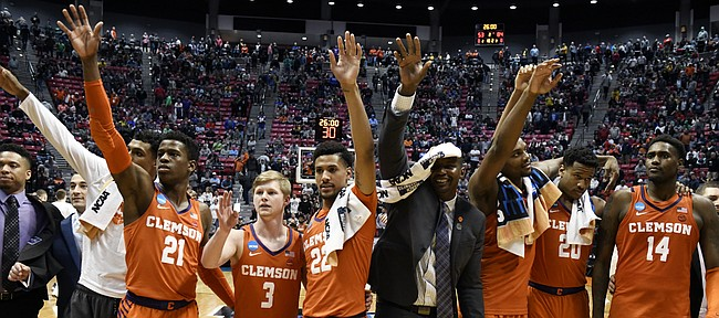 Clemson players celebrate after defeating Auburn 84-53 in a second-round NCAA men's college basketball tournament game Sunday, March 18, 2018, in San Diego. (AP Photo/Denis Poroy)