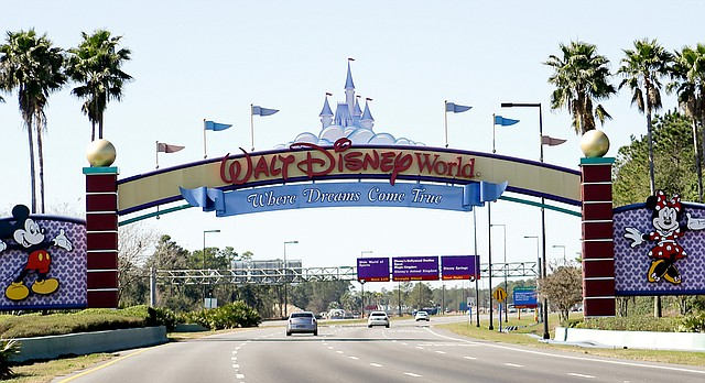 In this Tuesday, Jan. 31, 2017 file photo, cars travel one of the roads leading to Walt Disney World in Lake Buena Vista, Fla. (AP Photo/John Raoux)