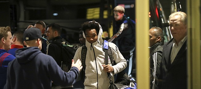 Kansas guard Devonte' Graham is greeted by a handful of KU fans as he and the rest of the players exit their bus upon arrival at the team hotel, Wednesday, March 21, 2018 in Omaha, Neb.