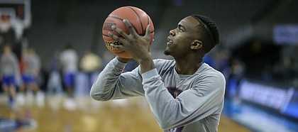 Kansas guard Lagerald Vick (2) lines up a shot during practice on Thursday, March 22, 2018 at CenturyLink Center in Omaha, Neb.