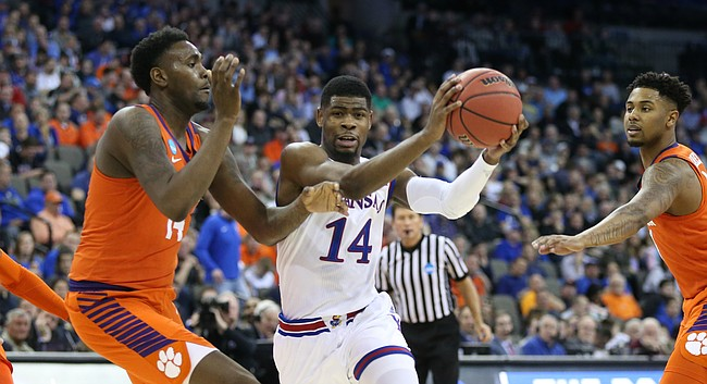Kansas guard Malik Newman (14) heads in against the Clemson defense during the first half, Friday, March 23, 2018 at CenturyLink Center in Omaha, Neb.