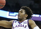 Kansas guard Devonte' Graham (4) heads in for a bucket during the first half, Friday, March 23, 2018 at CenturyLink Center in Omaha, Neb.