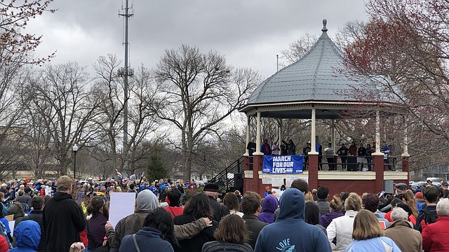 Free State High junior Ruth Gathunguri finishes speaking to the crowd at South Park before the March For Our Lives along Massachusetts Street, Saturday, March 24, 2018.