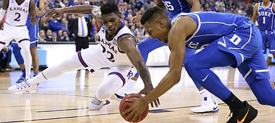 Kansas forward Silvio De Sousa (22) and Duke forward Javin DeLaurier (12) fight for a ball during the second half, Sunday, March 25, 2018 at CenturyLink Center in Omaha, Neb.