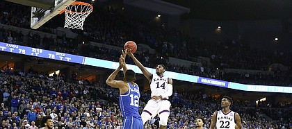 Kansas guard Malik Newman (14) floats in to the bucket against Duke forward Javin DeLaurier (12) during the second half, Sunday, March 25, 2018 at CenturyLink Center in Omaha, Neb.