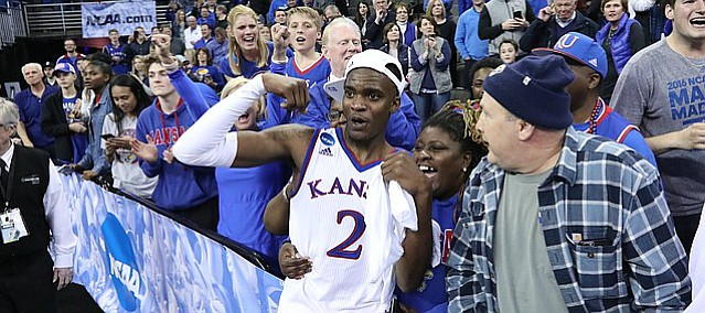 Kansas guard Lagerald Vick (2) flexes as he celebrates with his Final Four berth with his family following the Jayhawks' 85-81 overtime victory over Duke on Sunday in Omaha, Neb.
