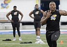 Dorance Armstrong tests his speed at Memorial Stadium during KU football Pro Day evaluations Tuesday at the Anderson Family Football Complex.
