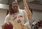 Lawrence High junior Chisom Ajekwu gathers herself before shooting a layup in the first quarter of the Lions' 57-34 win over Shawnee Mission East in the Class 6A sub-state semifinals on Tuesday at LHS.