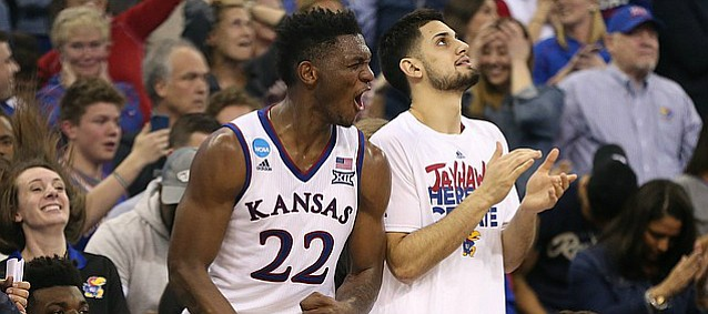 Kansas forward Silvio De Sousa (22) pumps his fists as the Jayhawks begin to solidify the victory during overtime, Sunday, March 25, 2018 at CenturyLink Center in Omaha, Neb.