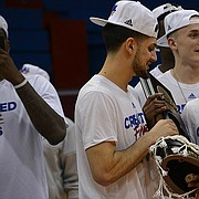 Sophomore guards Sam Cunliffe and Malik Newman hold an Elite Eight victory trophy at Allen Fieldhouse after the Jayhawk's 85-81 victory over Duke in Omaha, Neb. earlier in the day on Sunday, March 25, 2018. KU will face Villanova in the Final Four round of the NCAA tournament in San Antonio, Texas on Saturday.