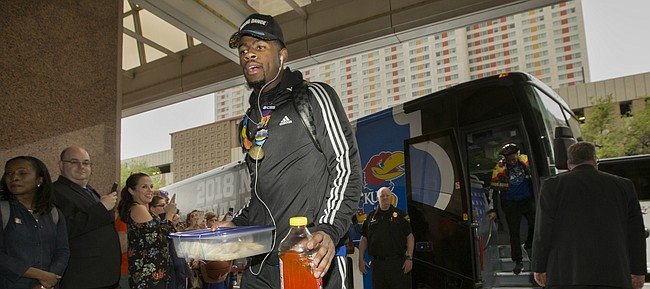 Kansas guard Malik Newman makes his way from the team bus as he and the rest of the team arrive at the team hotel on Wednesday, March 28, 2018 in San Antonio, Texas.