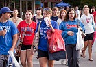 In this file photo from July 16, 2009, a crowd of shoppers crosses an intersection in downtown Lawrence.