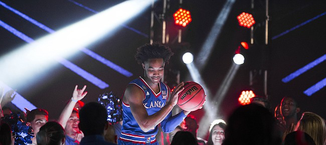 Kansas guard Devonte' Graham pump fakes with a ball as he dances on a stage before fans during a video recording with Turner CBS on Thursday, March 29, 2018 at the Alamodome in San Antonio, Texas.
