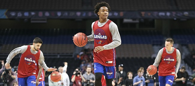 Kansas guard Devonte' Graham (4) dribbles the ball up the court during a practice on Friday, March 30, 2018 at the Alamodome in San Antonio, Texas.