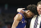 Kansas head coach Bill Self puts his arm around a tearful Devonte' Graham (4) as Graham checks out of the game with seconds remaining, Saturday, March 31, 2018 at the Alamodome in San Antonio, Texas.