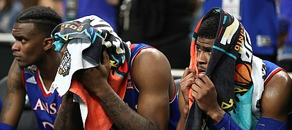 Kansas guard Malik Newman (14) peeks out from a towel as he watches the final seconds of the Jayhawks' 95-79 loss to Villanova on Saturday, March 31, 2018 at the Alamodome in San Antonio, Texas.