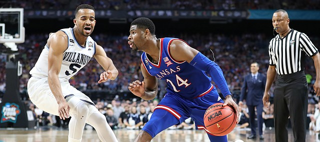 Kansas guard Malik Newman (14) pulls back to shoot against Villanova guard Phil Booth (5) during the second half, Saturday, March 31, 2018 at the Alamodome in San Antonio, Texas.