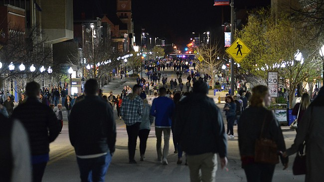 Kansas basketball fans walk on Massachusetts St. after the Jayhawks played in the Final Four on Saturday, March 31, 2018. The city closed the street to traffic and parking temporarily. KU lost to Villanova, 95-79.