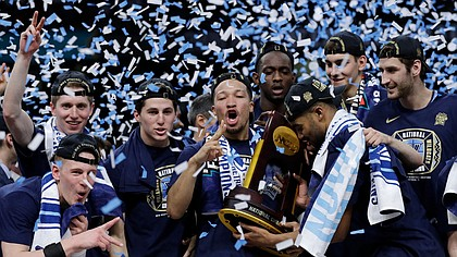 Villanova players celebrate with the trophy after beating Michigan, 79-62, in the championship game of the Final Four NCAA Tournament on Monday, April 2, 2018, in San Antonio.