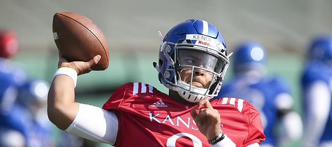 Kansas sophomore quarterback Miles Kendrick throws during practice on Wednesday, April 4, 2018.