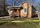 Yellow tape surrounds a house at 1129 Connecticut St. on Wednesday, April 4, 2018. Lawrence police were investigating the fatal shooting of a man on the porch in the early morning hours.