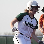 Free State junior LJ Jones stops at third base following a wild pitch in the fourth inning of the Firebirds' 2-1 loss to Shawnee Mission Northwest on Thursday at FSHS.