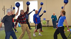 Suzie Craig, a physical therapist at LMH Therapy Services, leads a recent exercise class for people with Parkinson's disease.  Participants, from left, John Strother, Jay Hilty and Wayne Osness gather at Sports Pavilion Lawrence twice a week for the class.