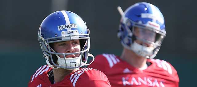 Kansas quarterback Peyton Bender (7) drops back to pass during practice on Wednesday, April 4, 2018, as Carter Stanley (9) observes.