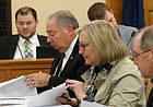 Members of the Kansas Senate's negotiating team on school finance look over an initial compromise offer from the House during the first round of conference committee talks Friday evening. They include Republican Sens. Jim Denning, left, of Overland Park, and Molly Baumgardner, of Louisburg, and Democratic Sen. Anthony Hensley, of Topeka.