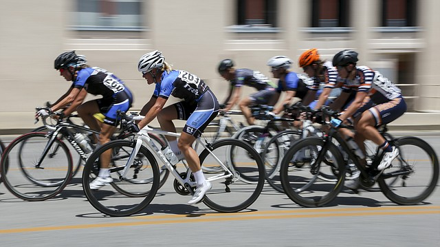 Cyclists compete during the Women's Pro 1/2/3 races of the 2016 Tour of Lawrence Downtown Criterium Race, Sunday, July 17, 2016.